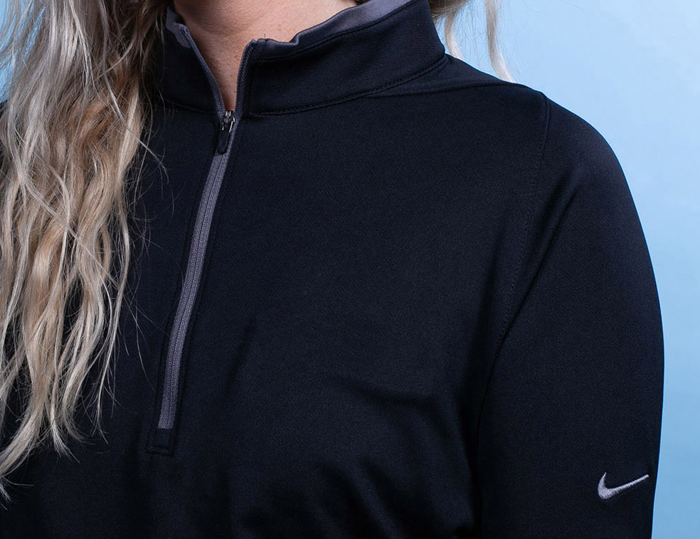 A Nike zip-up jacket with custom embroidery