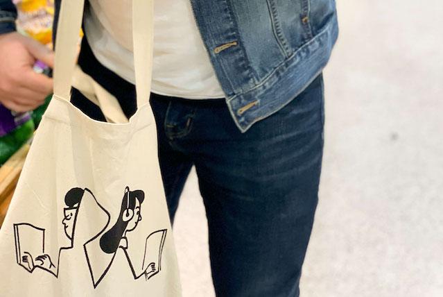 Man shopping with custom reusable shopping bag