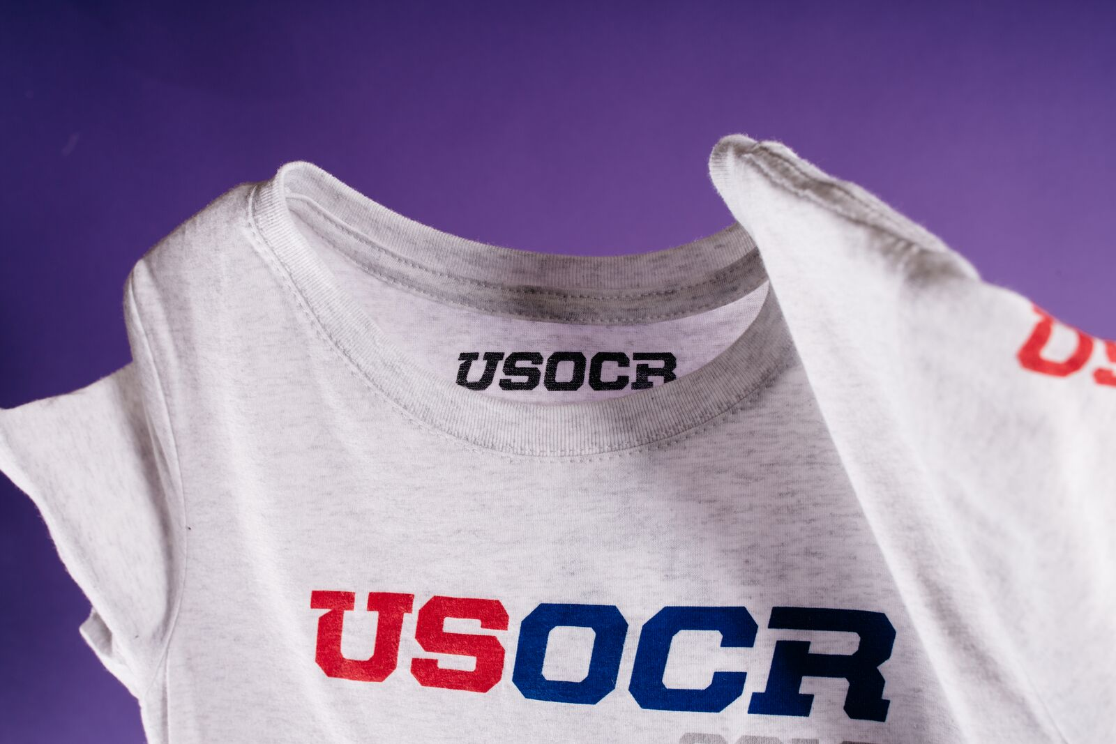 white shirt with red and blue USOCR print
