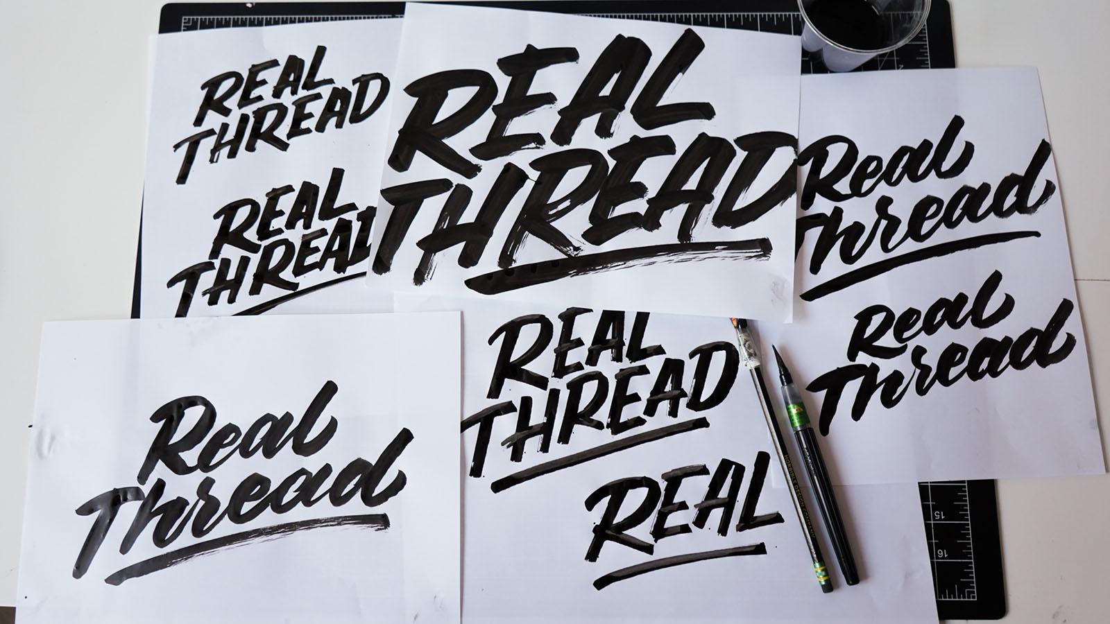 real thread hand lettered samples on desk