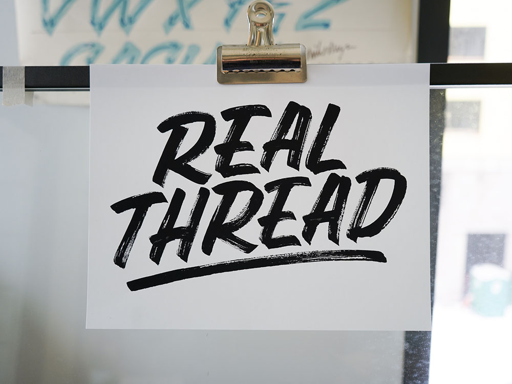 real thread hand letting clipped onto wall divider