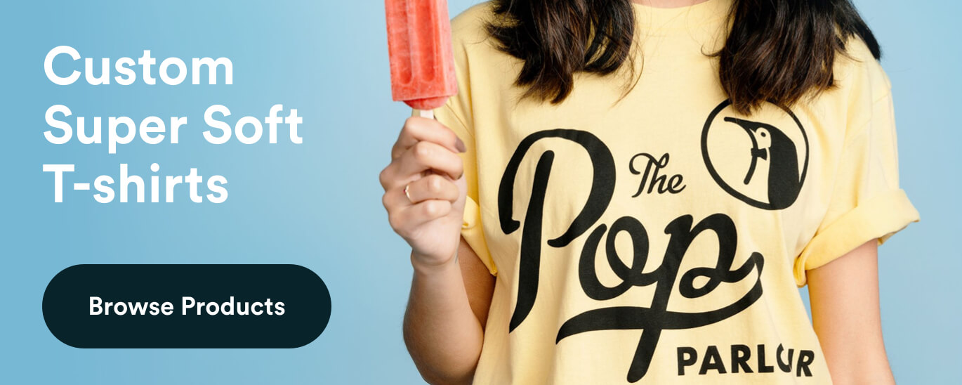 girl holding popcicle in yellow shirt