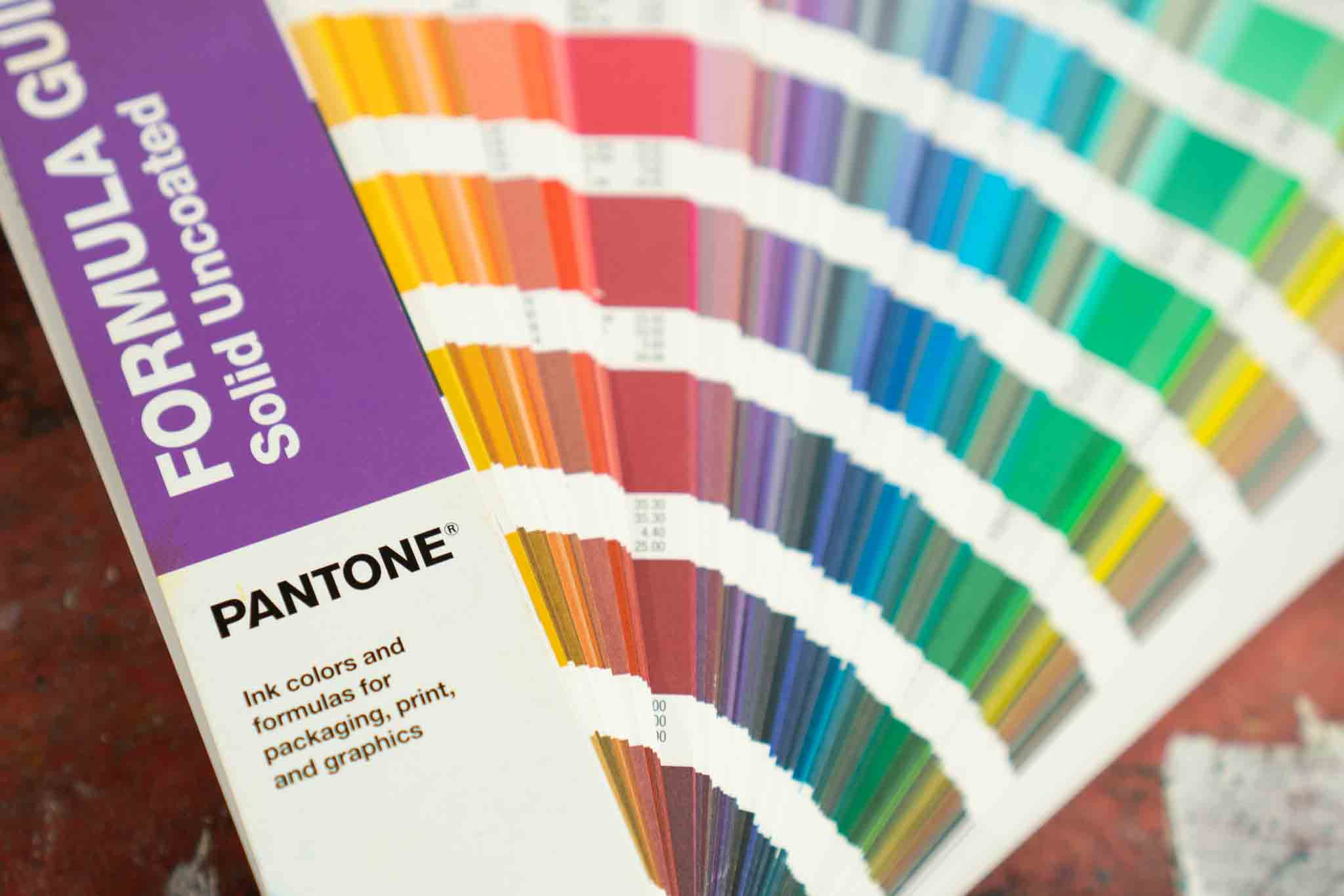 open pantone swatch book showing multiple colors and shades