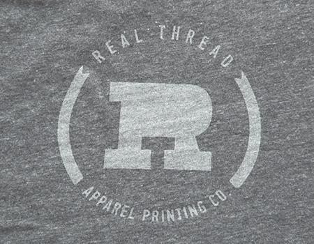 real thread light grey logo on grey shirt