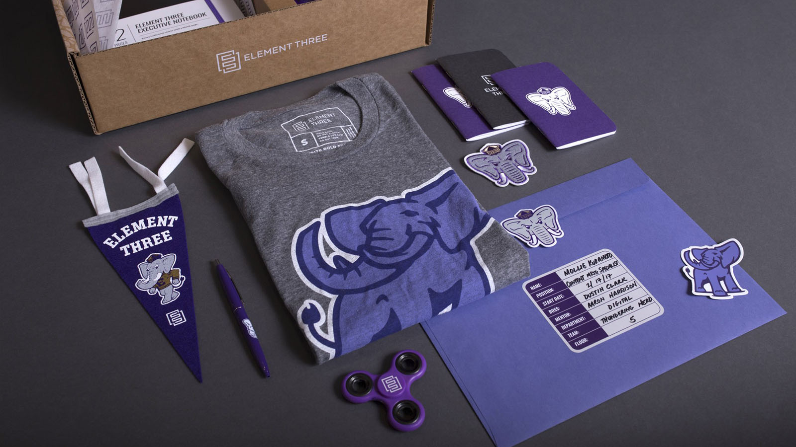 swag merchandise and box flat lay