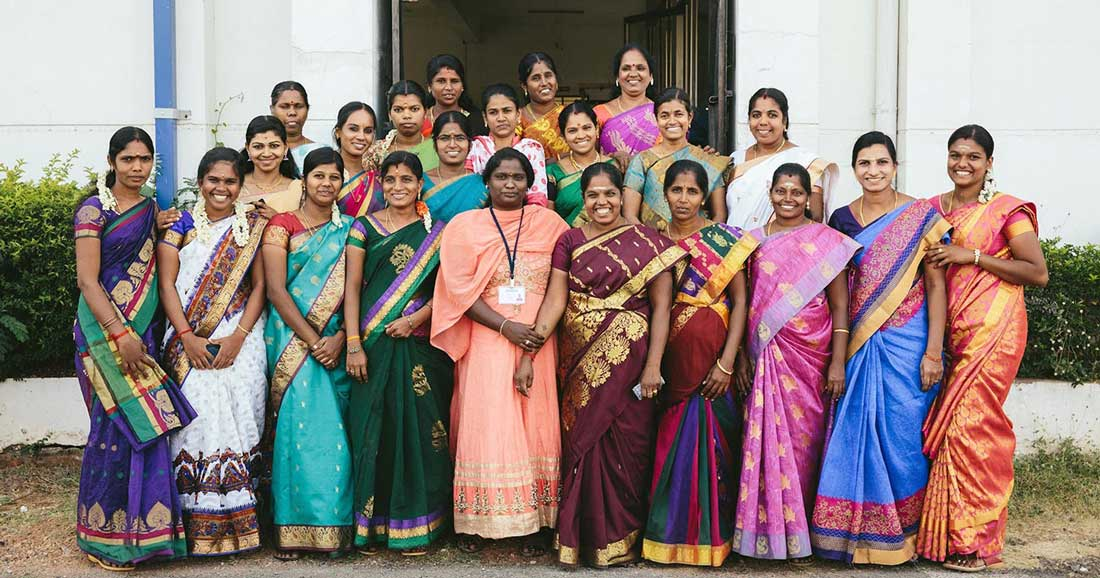 a group of Indian women standing together