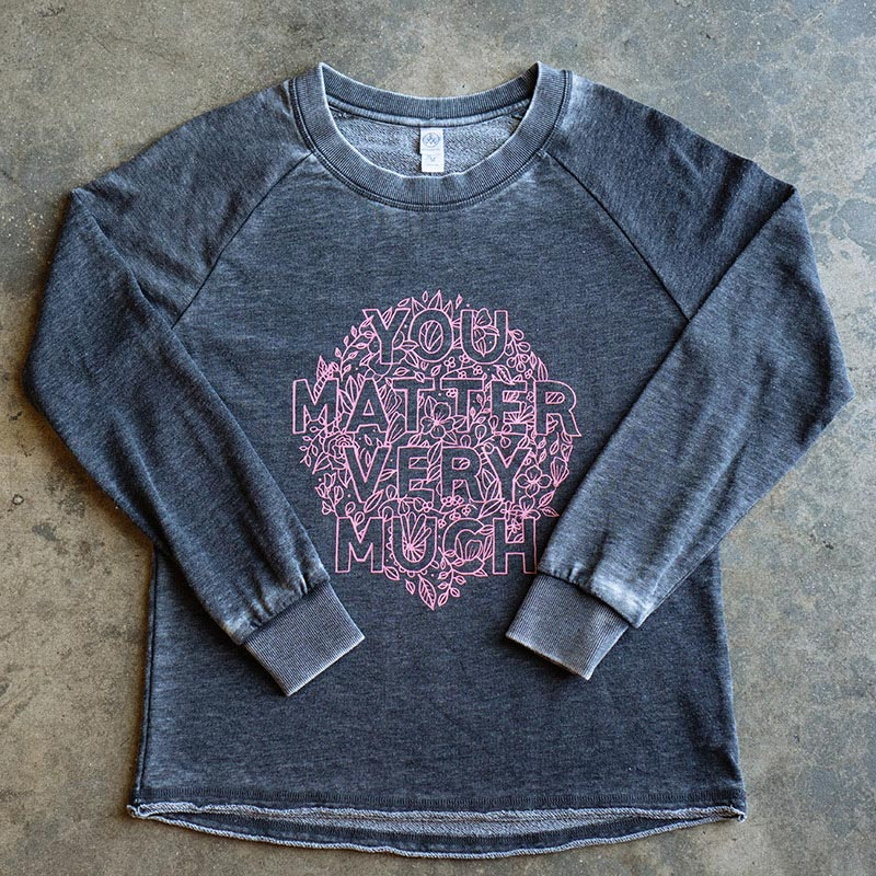 grey shirt with pink graphic