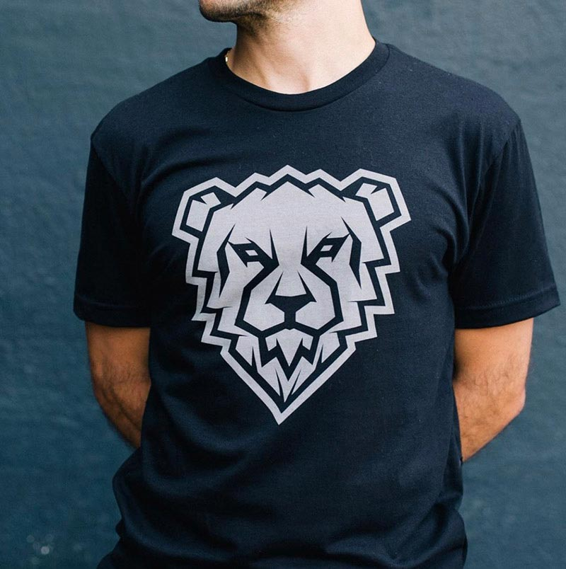 man showing black shirt with white bear graphic