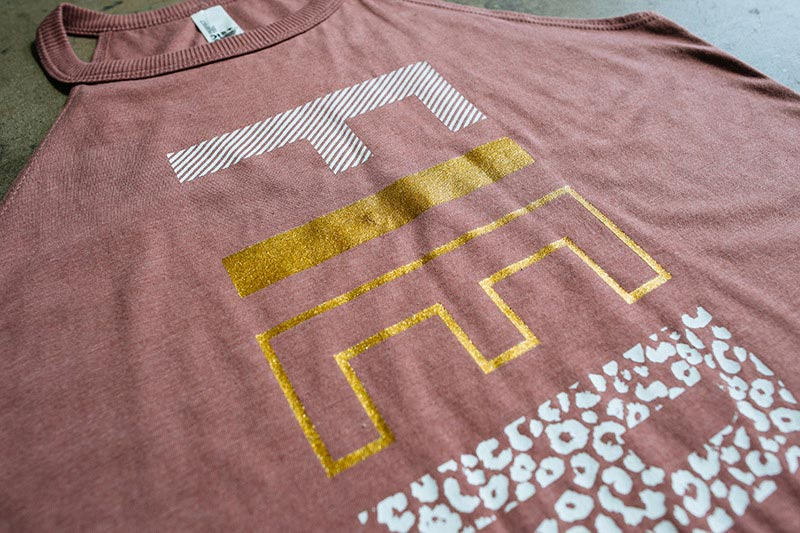 pink shirt with gold foil printing