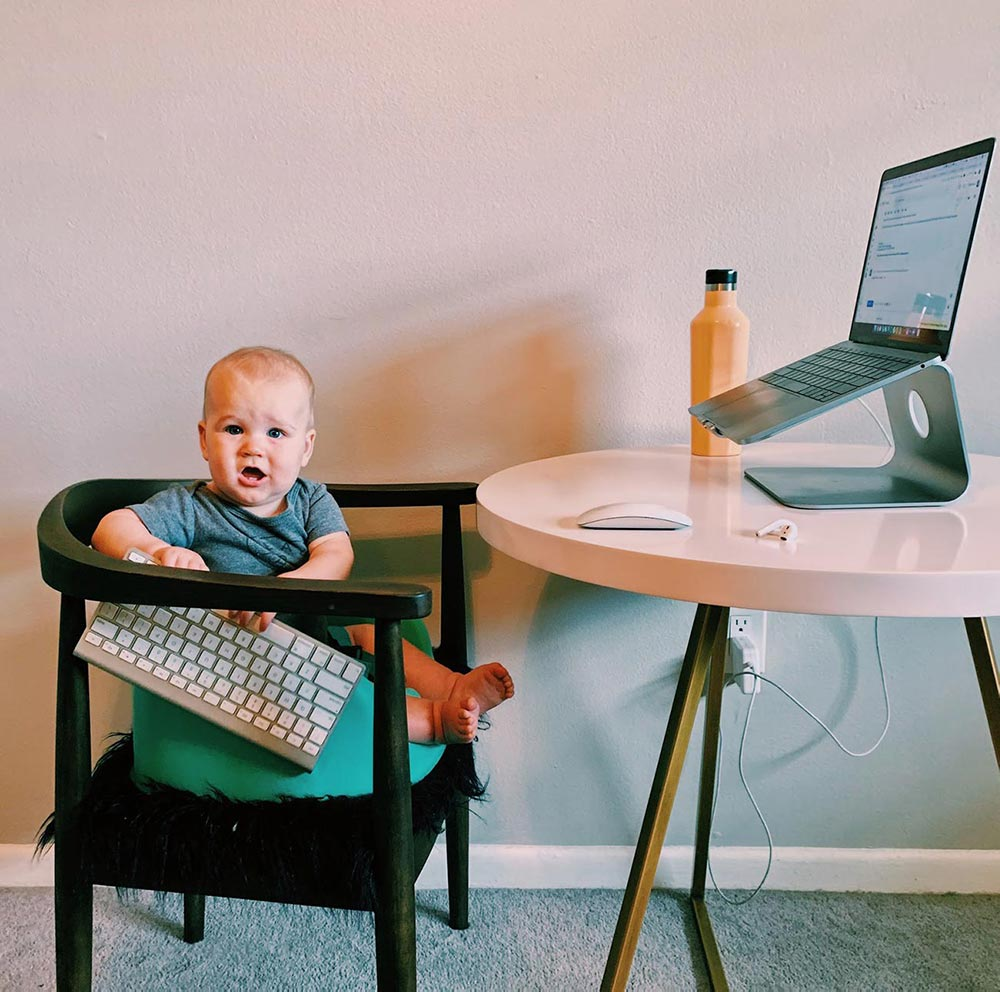 baby on chair with keyboard