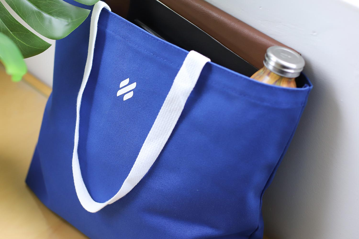 Help Scout Blue Custom Tote Bag filled with a Bottle