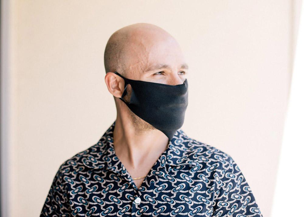 bald man wearing face mask