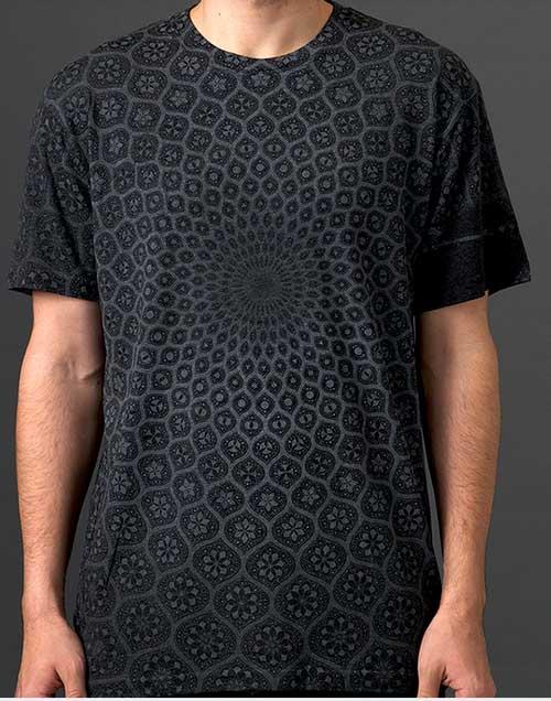 man wearing black shirt with pattern