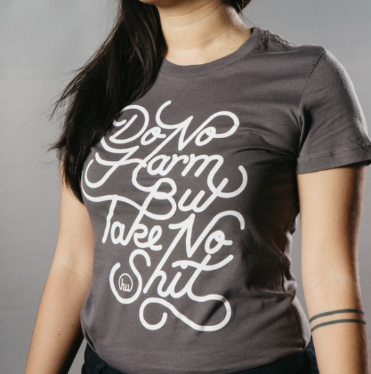 woman wearing shirt with white script front
