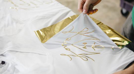 hand pulling gold foil print