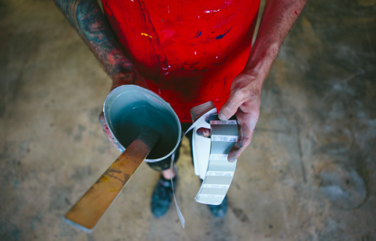 man holding ink mixing supplies