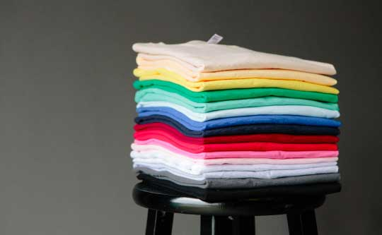 stack of folded colorful shirts
