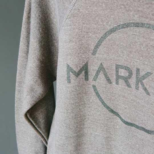 grey sweatshirt with black mark graphic