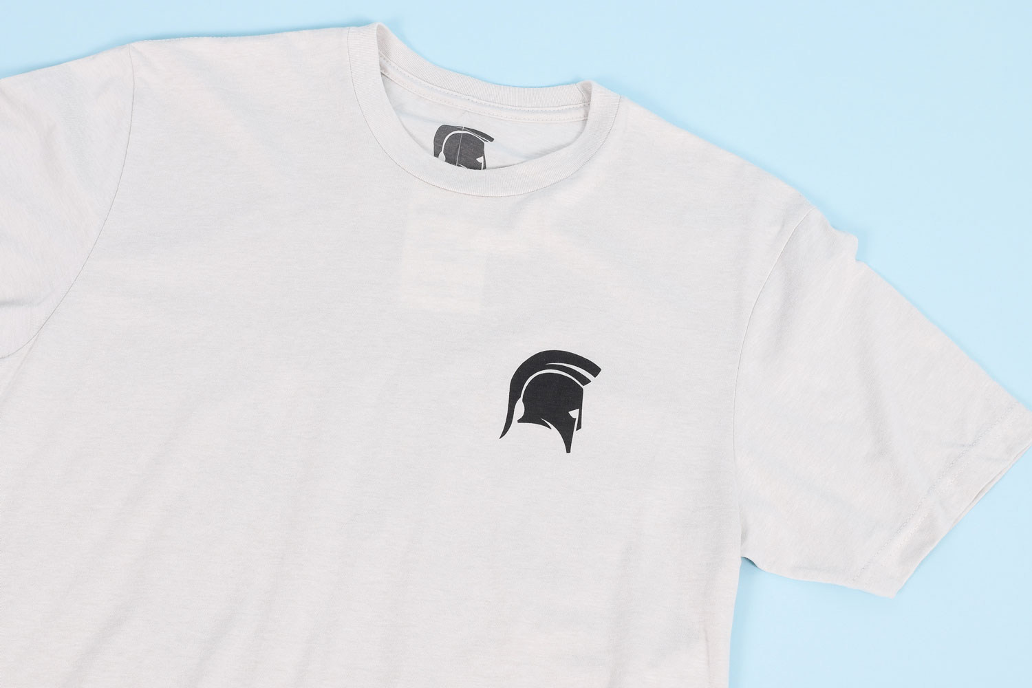 white t-shirt with small black spartan helmet logo on chest