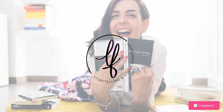 Linda Franzosi laughing holding a book