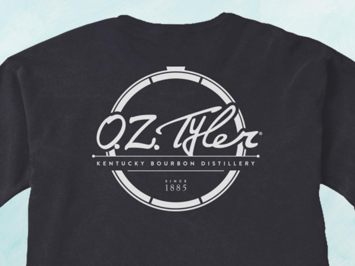 Black sweatshirt with white circle outline logo and O.Z. Tyler spelled out