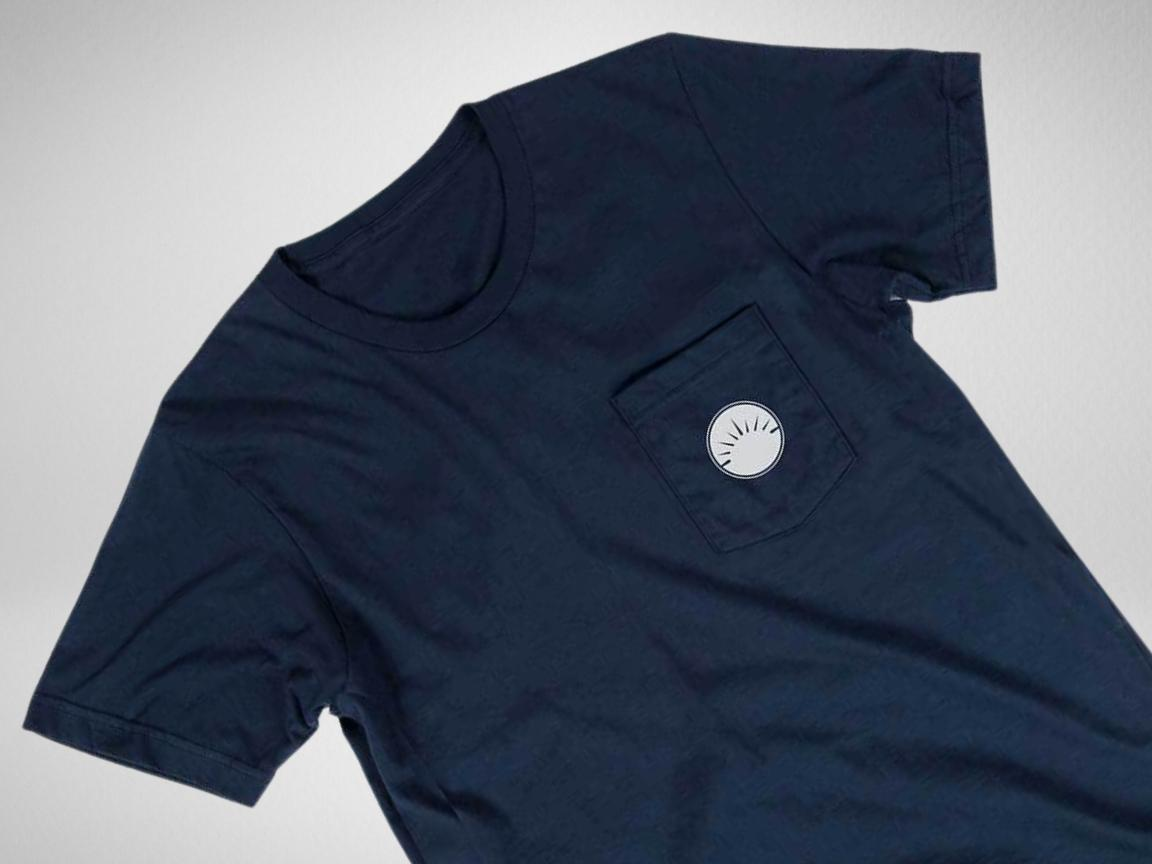 Navy pocket t-shirt with white circle logo against a white background