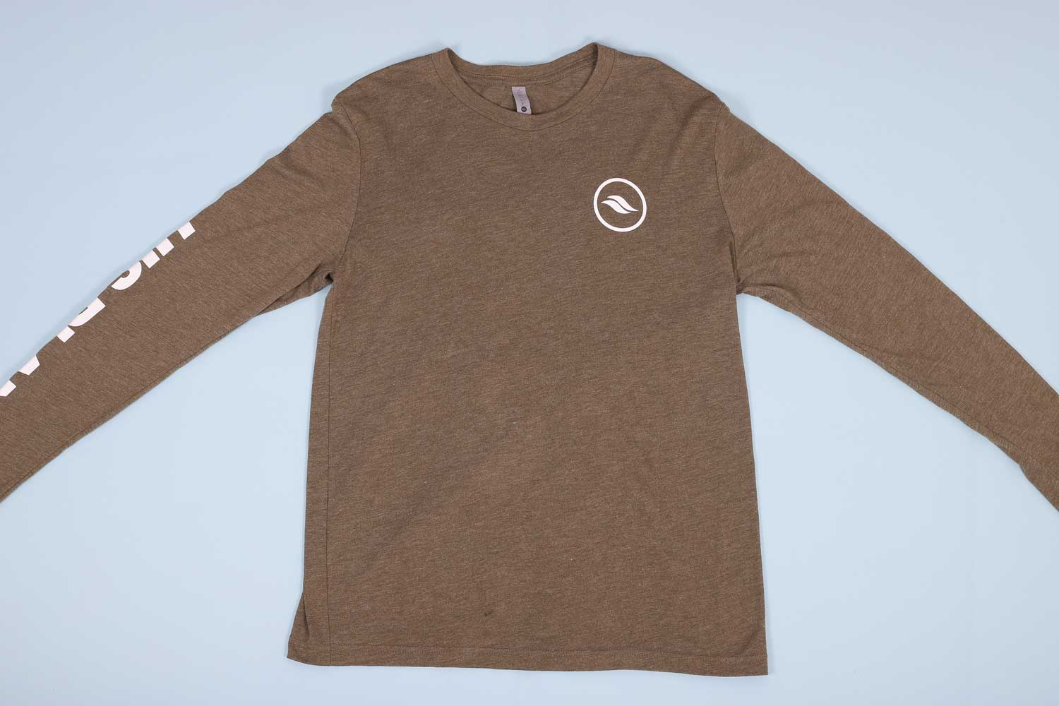 Olive long sleeve t-shirt laying out flat on a light blue background