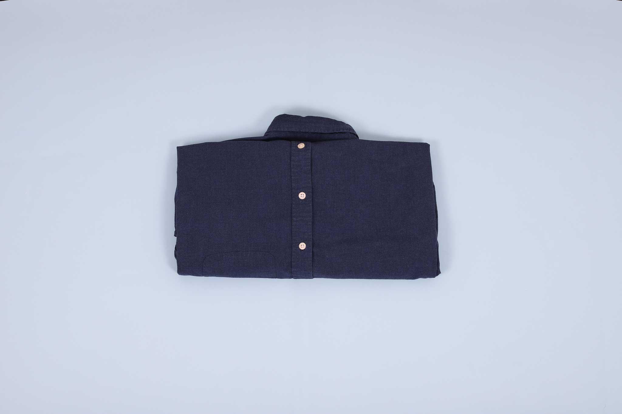 Navy dress shirt folded into thirds facing down