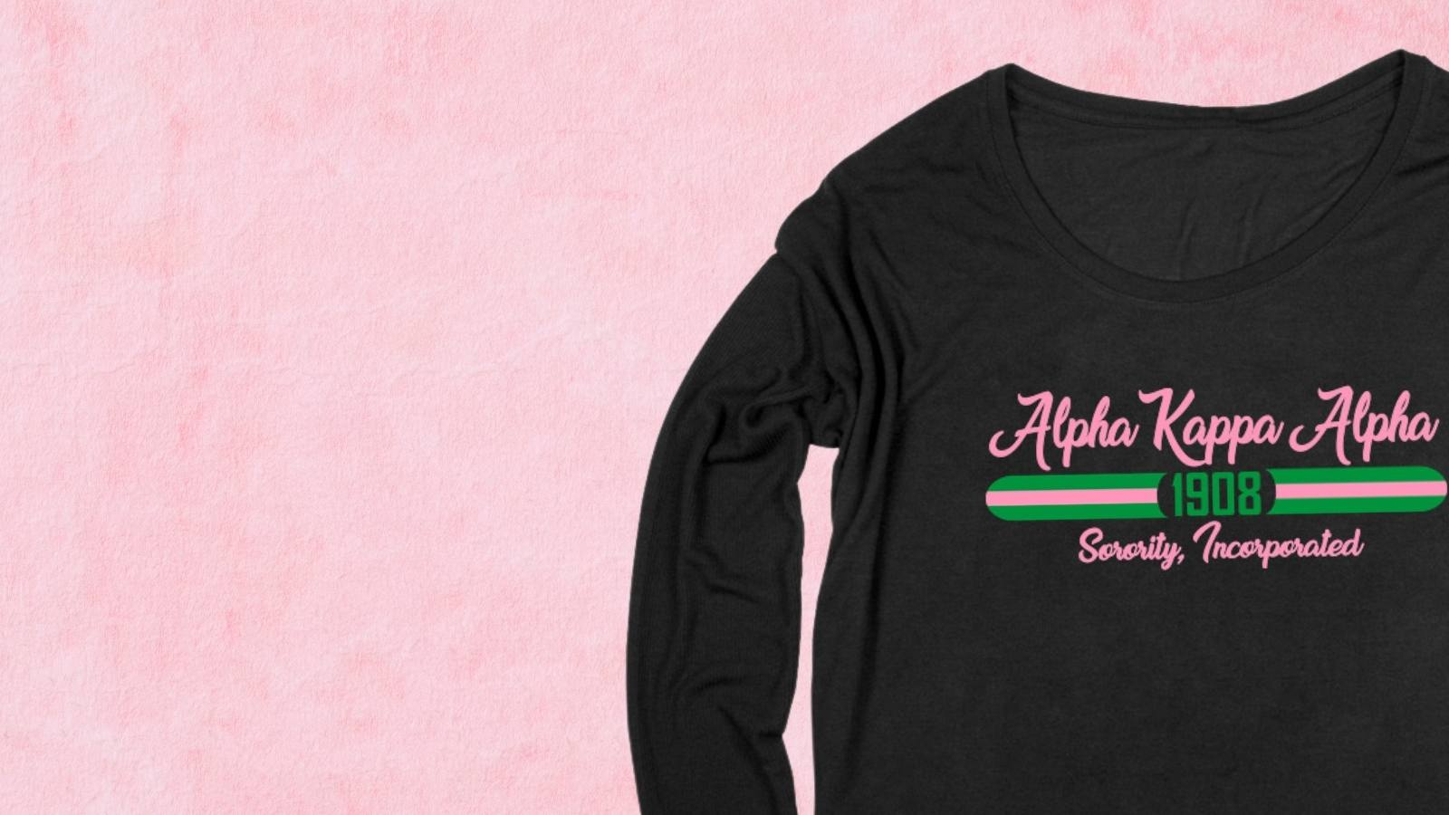 Black sorority long sleeve t-shirt with pink and green text on a pink background