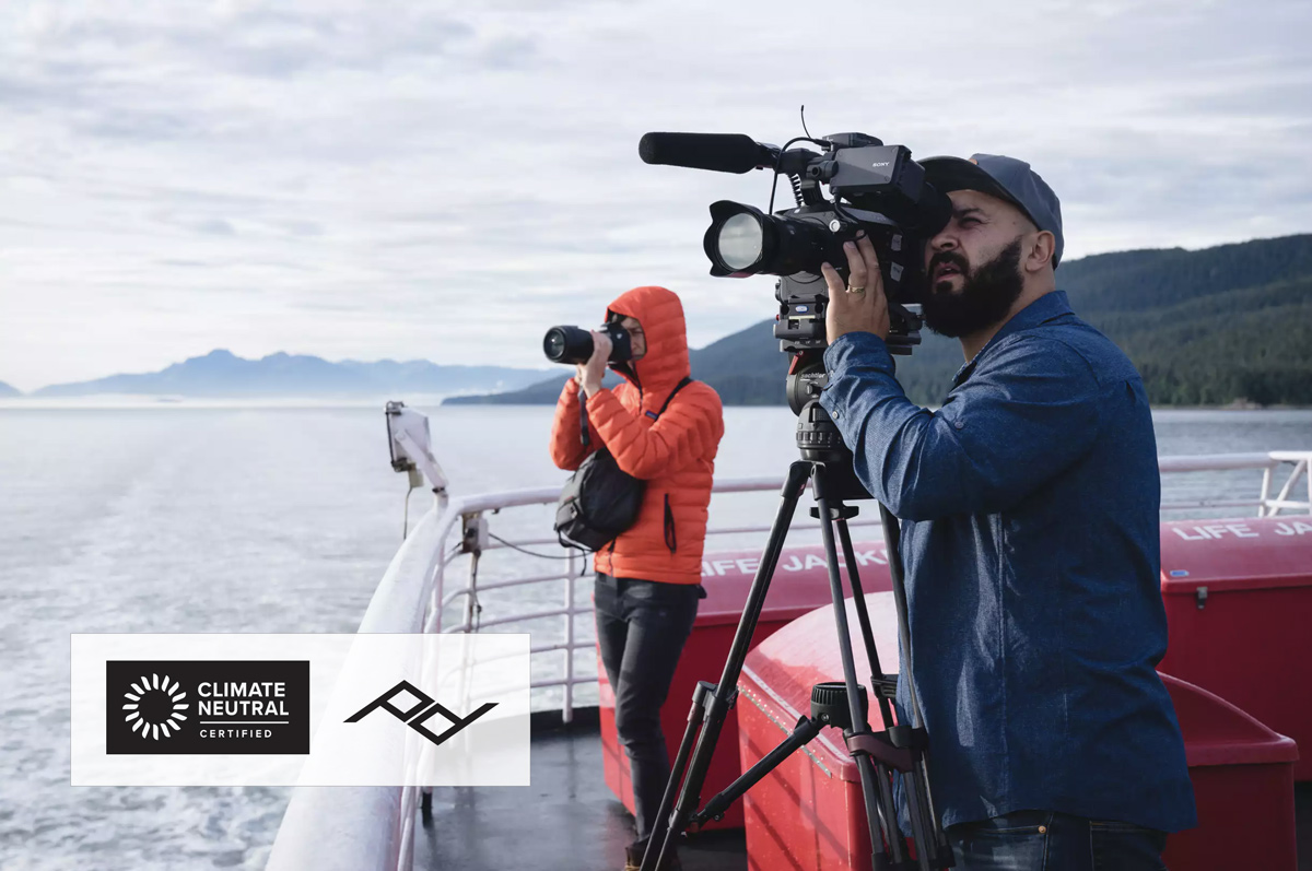 Videographer and photographer on a boat