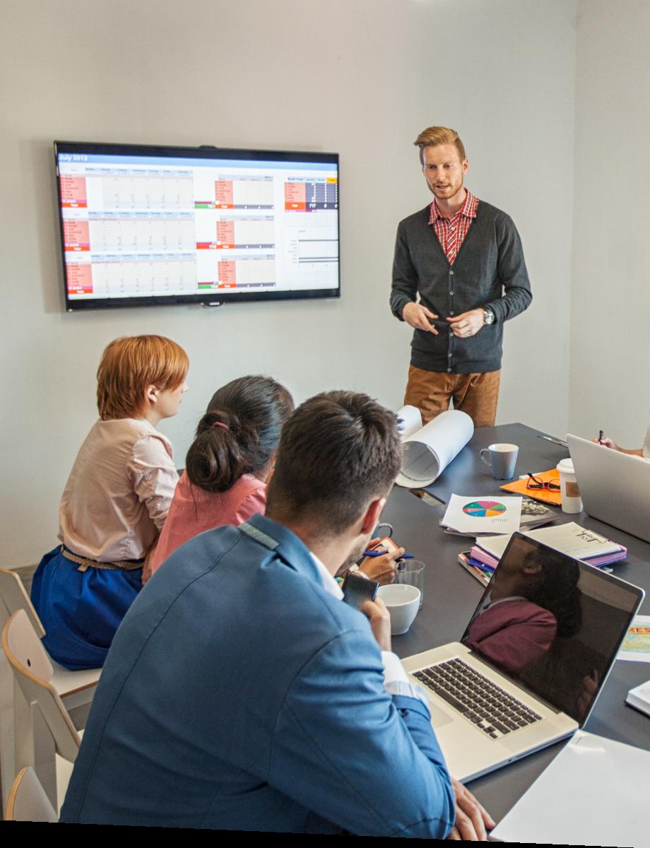 Man presenting in a team meeting