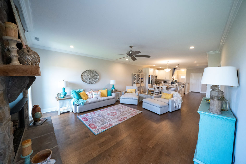 Wide angle view of living room and kitchen of lake villa