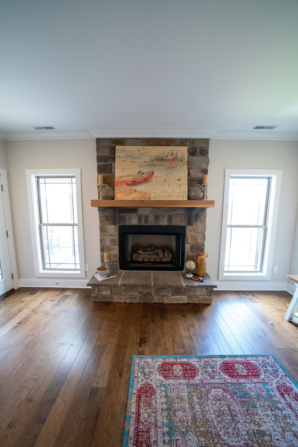 Fireplace and painting in lake villa
