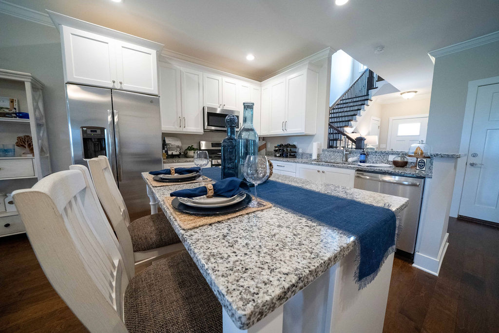 Kitchen bar counter with dinner plates and chairs