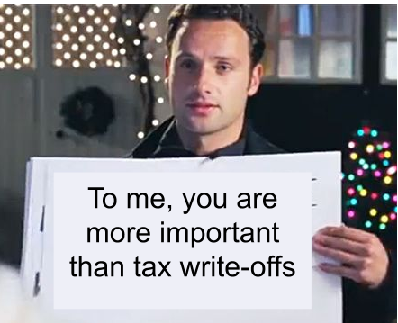 holding a sign: gift to clients tax deductible