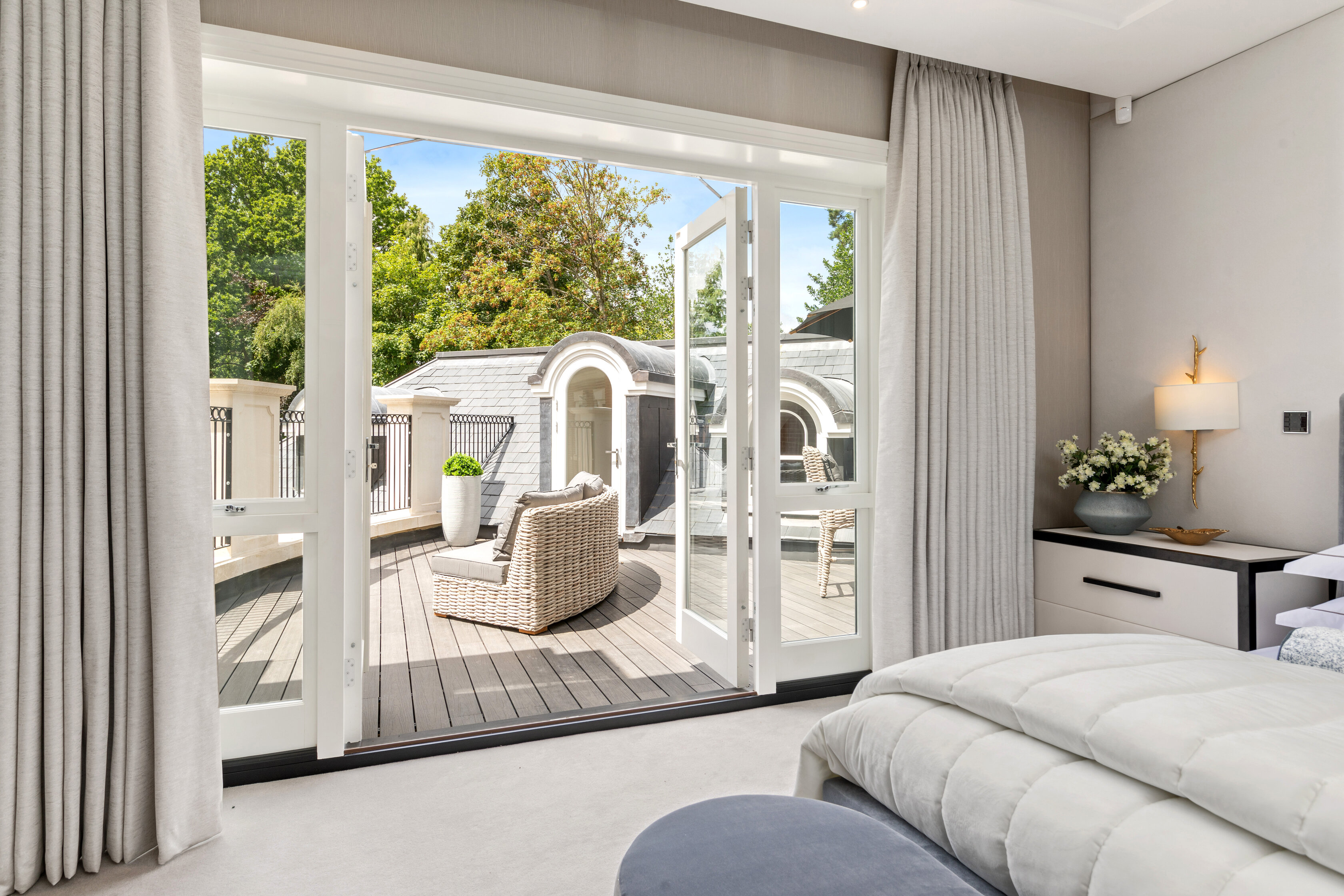 Master bedroom leading onto bright terrace