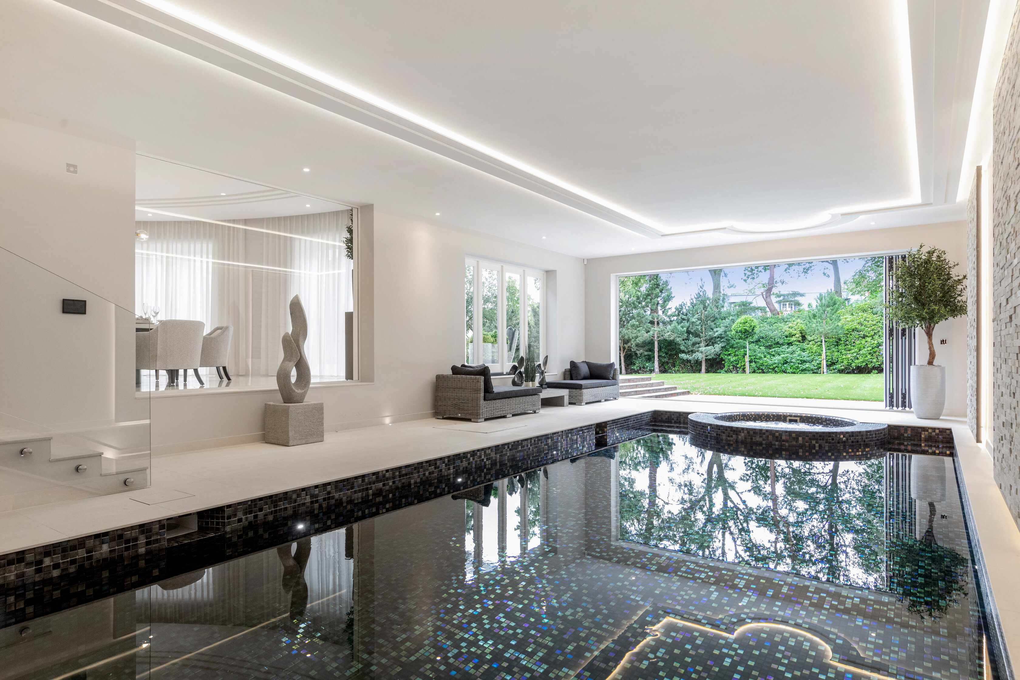 indoor luxurious pool opening onto the garden