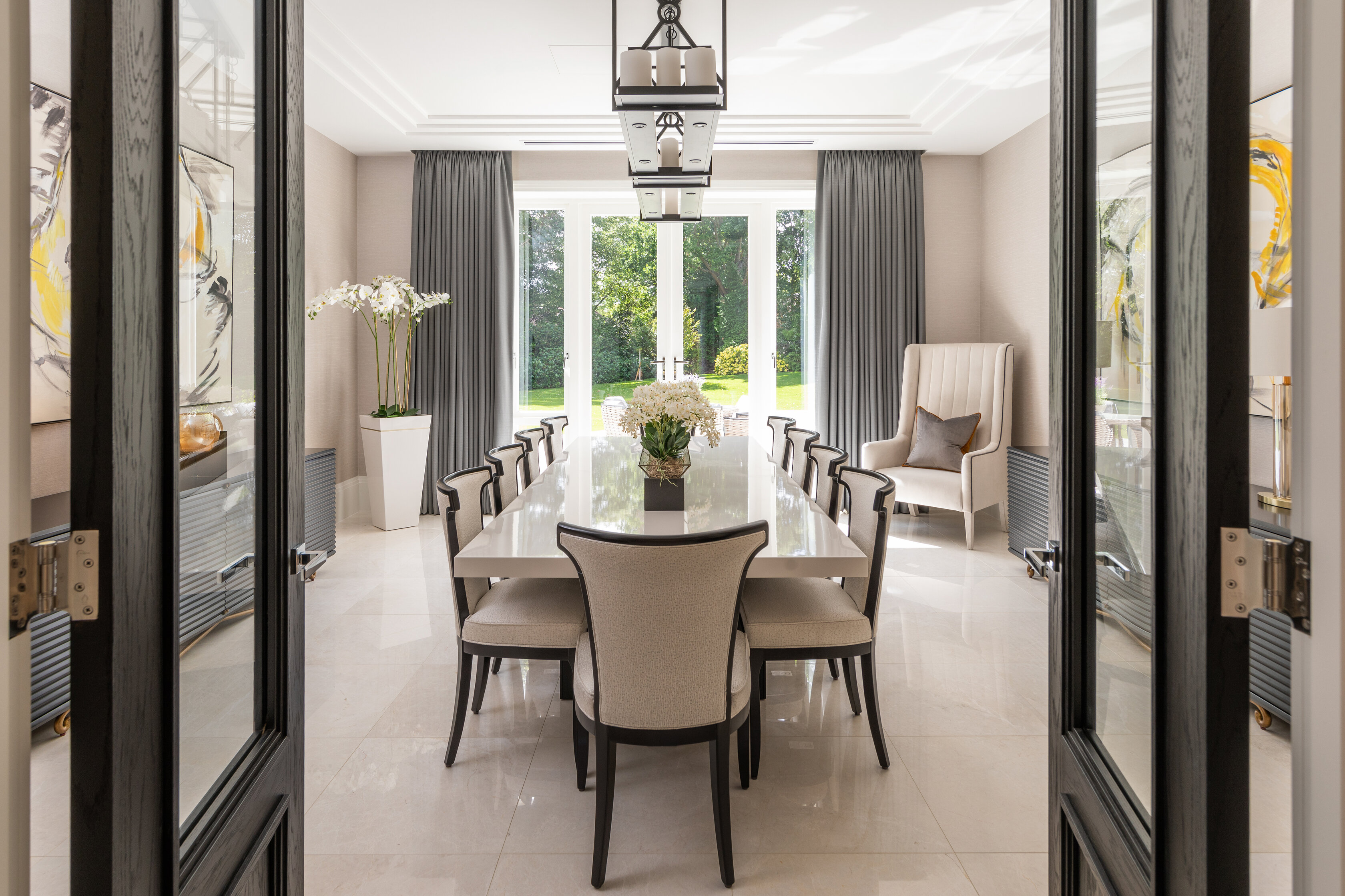 dining room with stylish decor and double doors