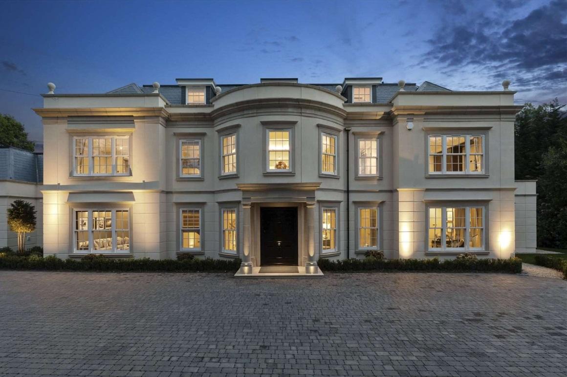white mansion front elevation at dusk