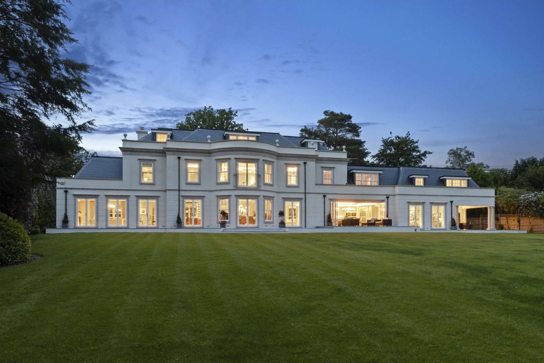 White mansion at dusk rear elevation