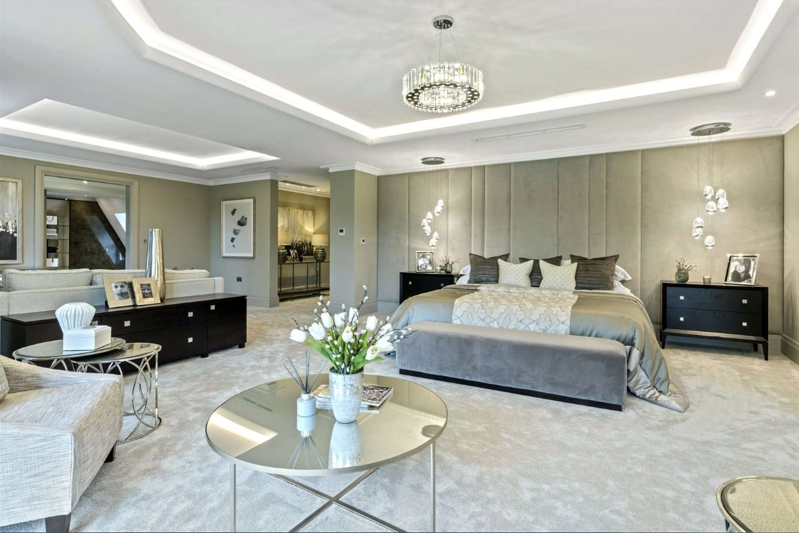 master bedroom in mansion with bright interior