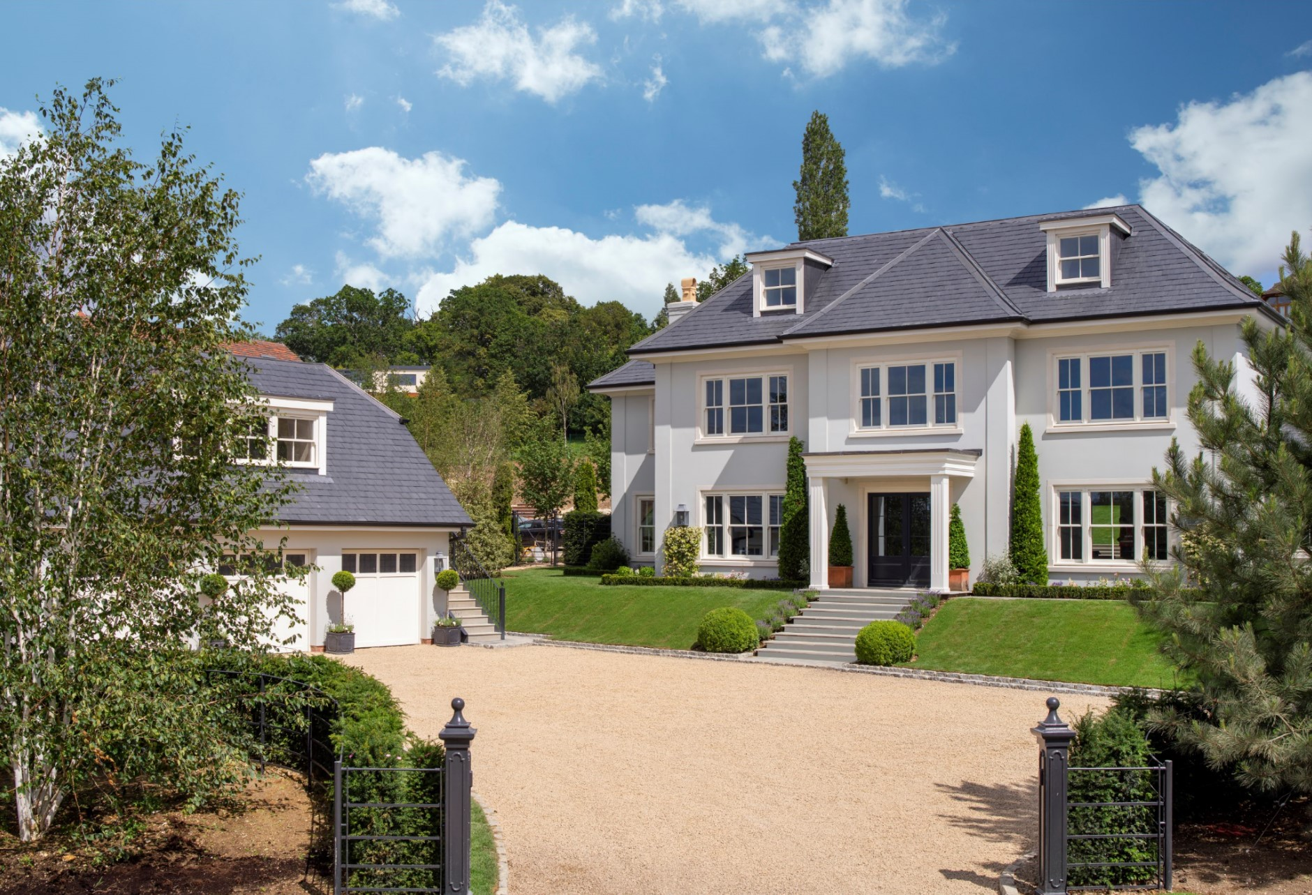 Luxury new white render home with large driveway
