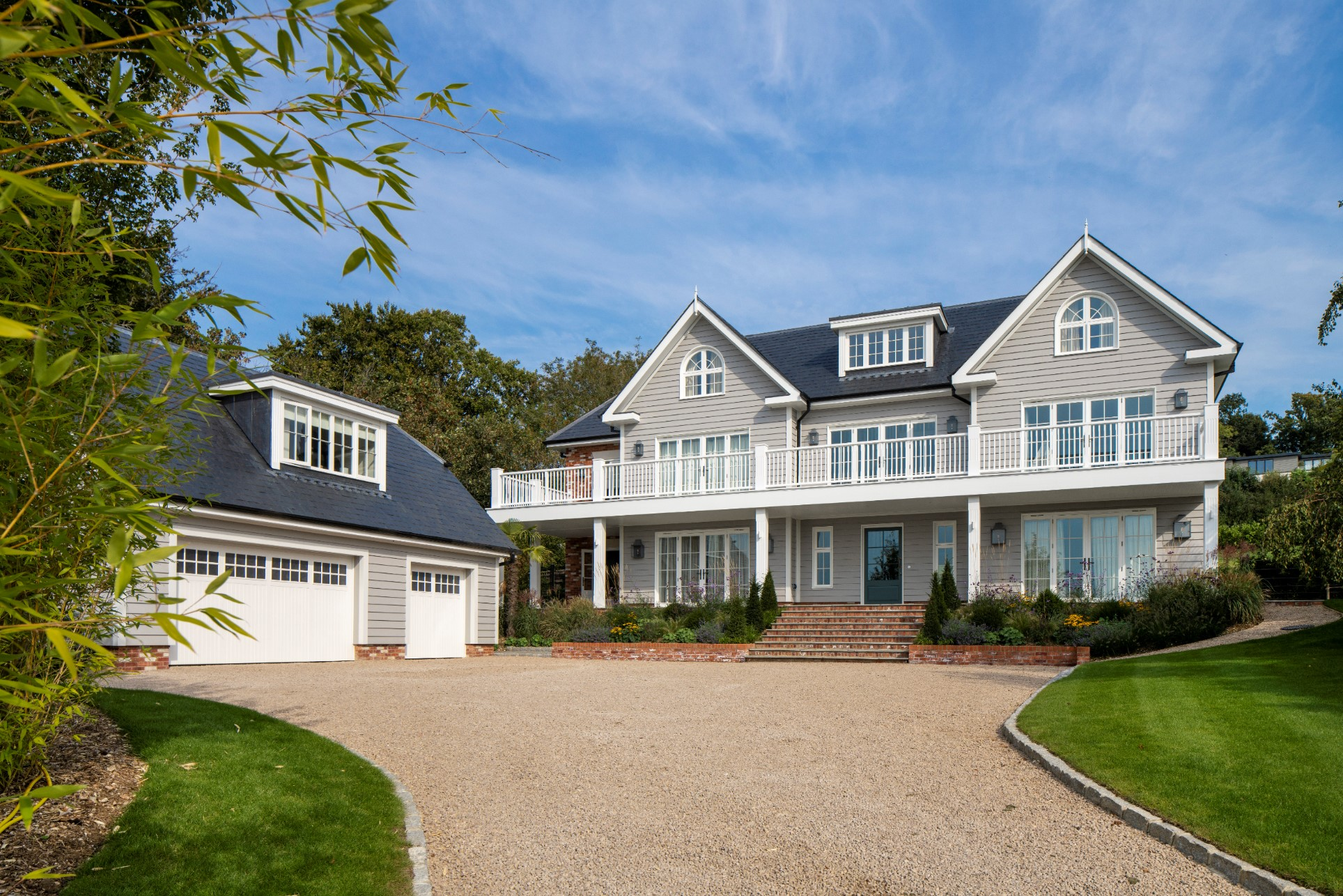 A large new white home with large driveway