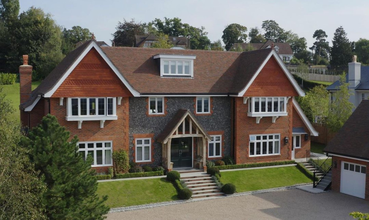 A tudor style red brick and tile hanging home