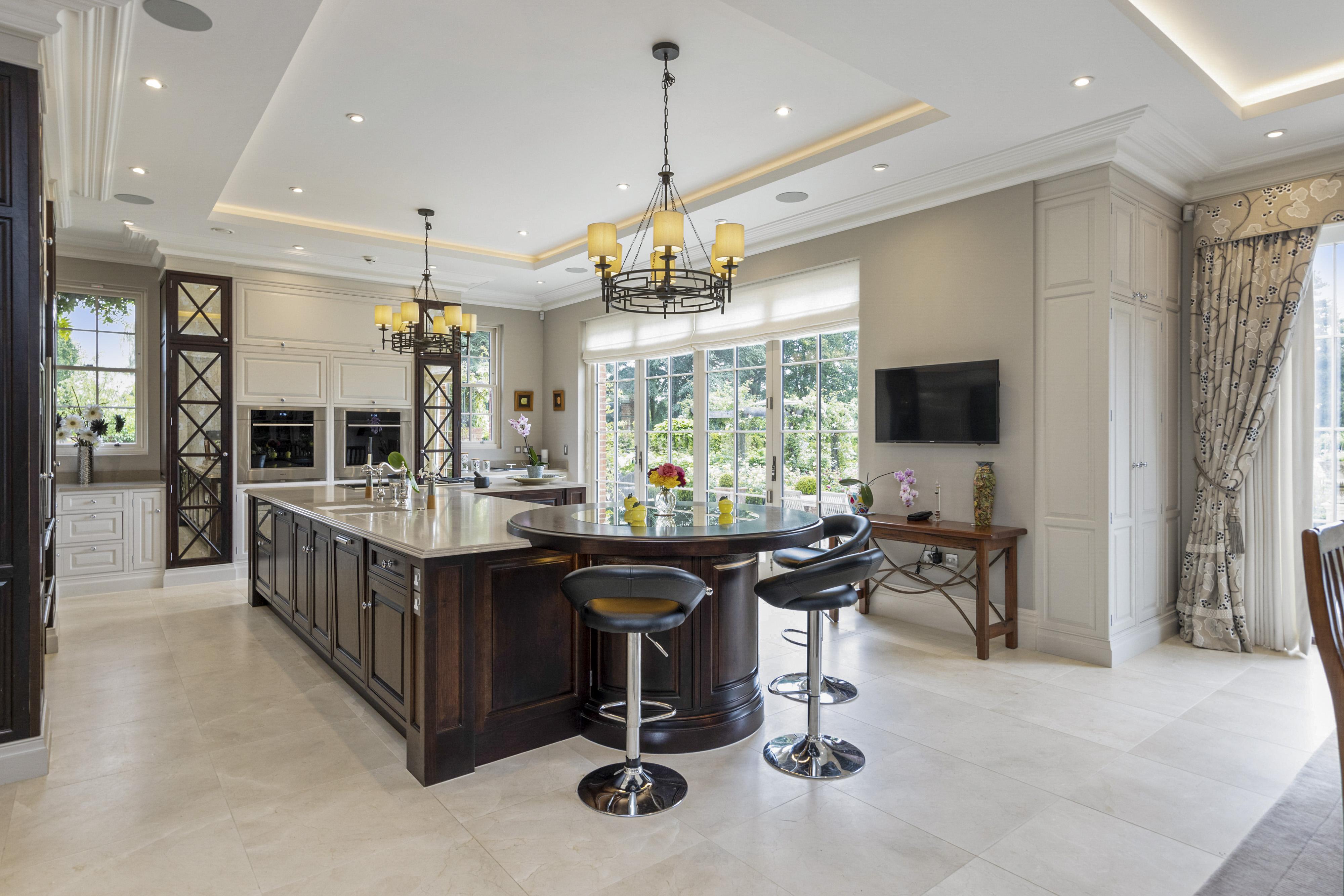 a large open plan kitchen with dark oak island