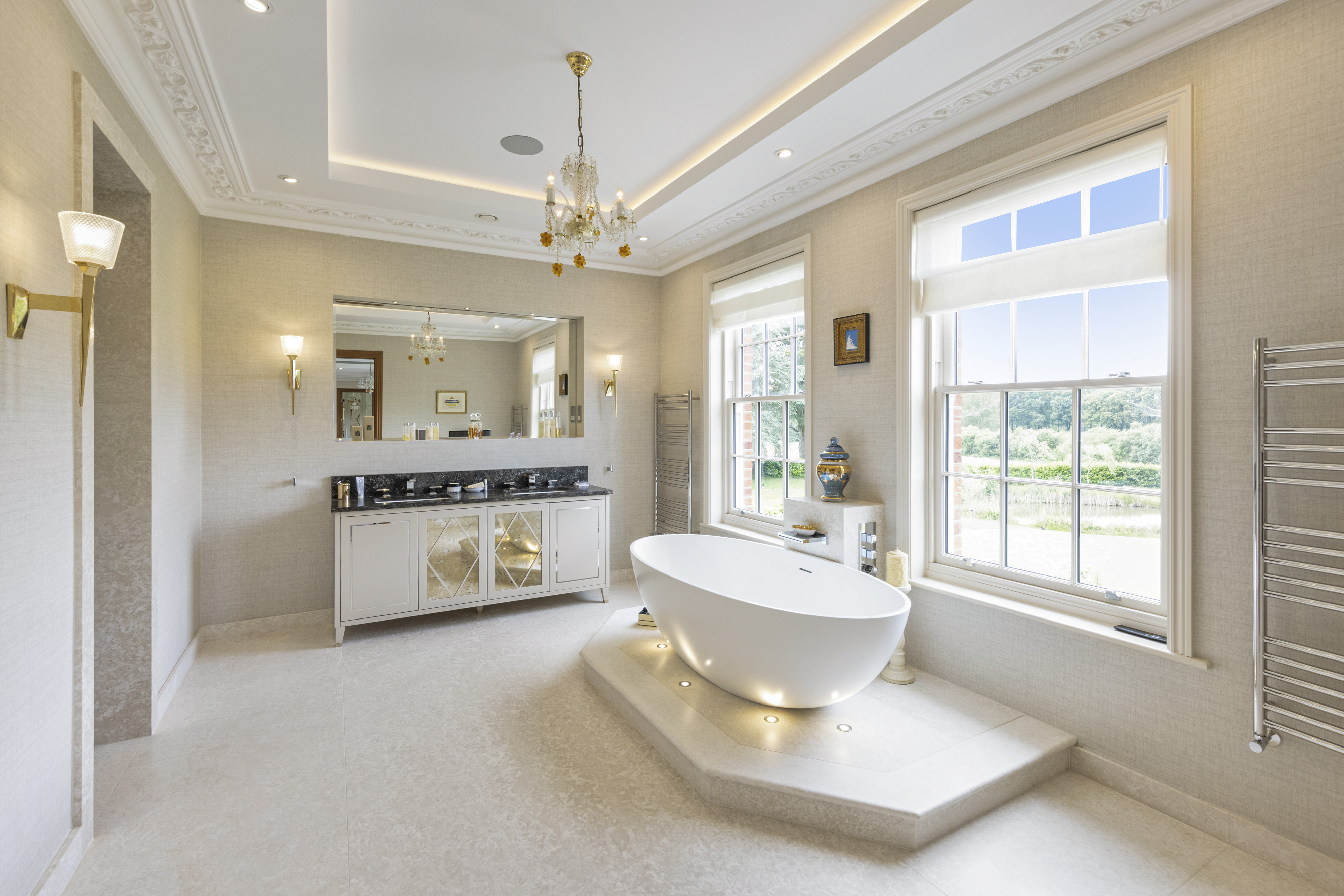 a large bathroom with stand alone bath