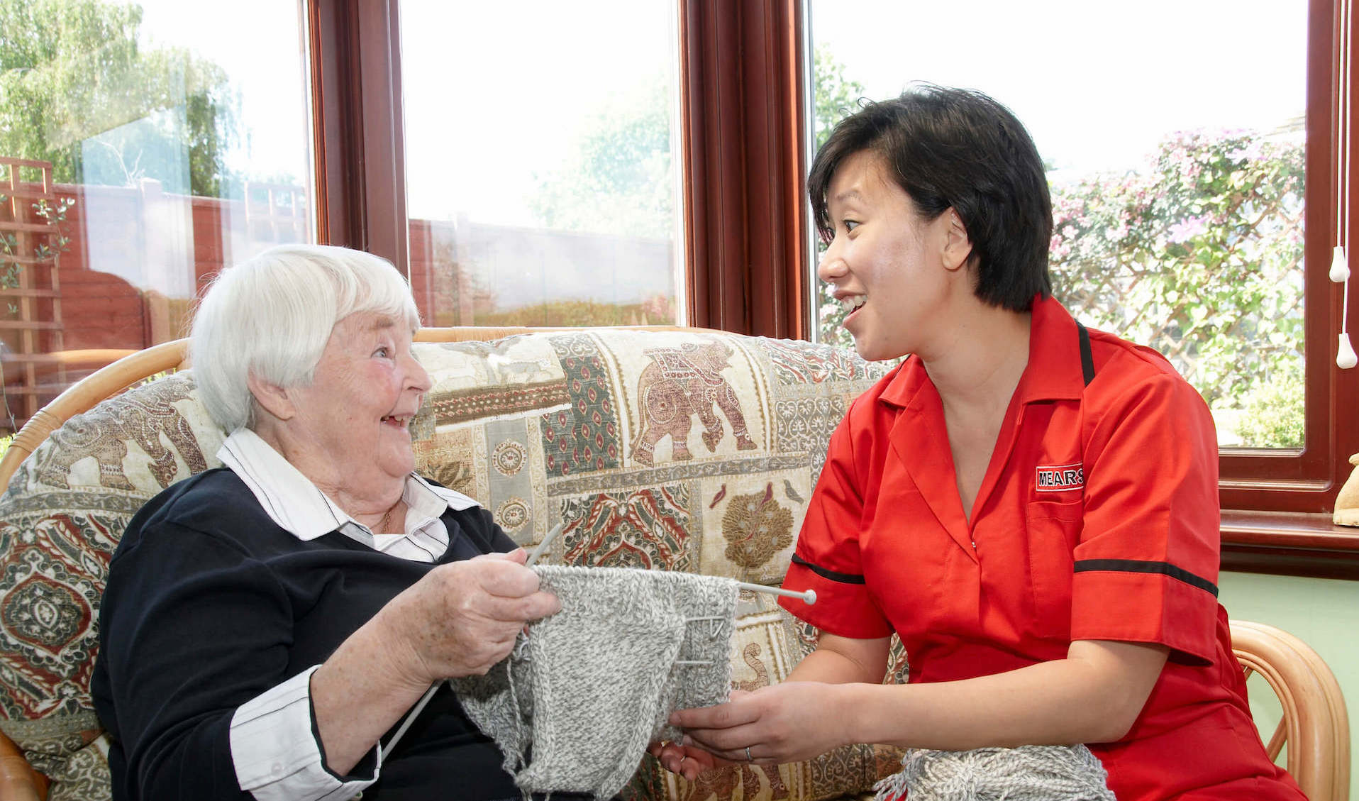 Mears carer with a service user who is knitting