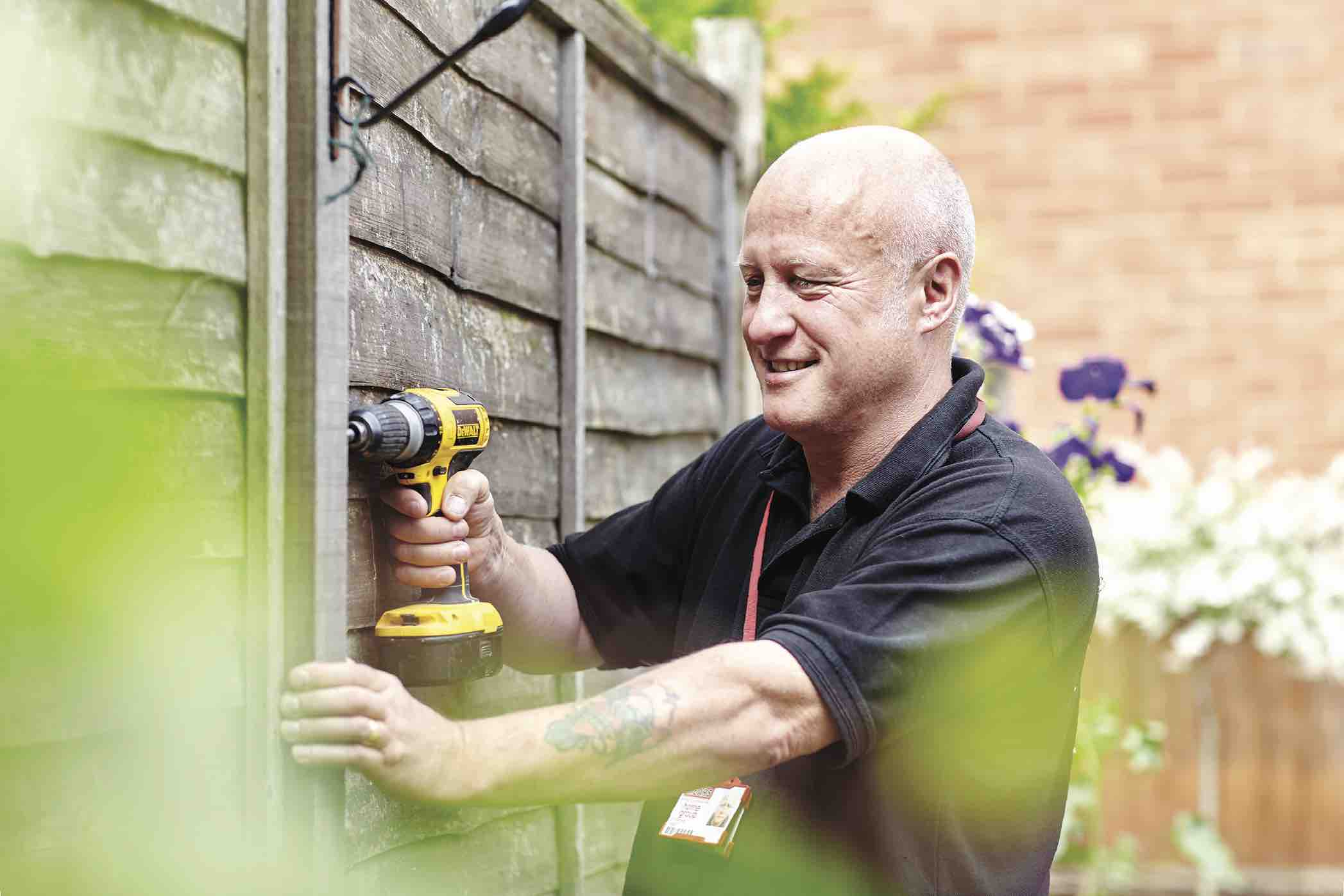 Mears colleague repairing a fence outside