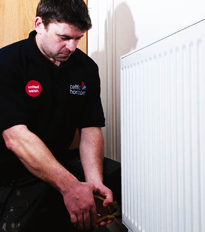 United Welsh employee fixing a radiator