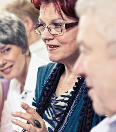 Three individuals talking